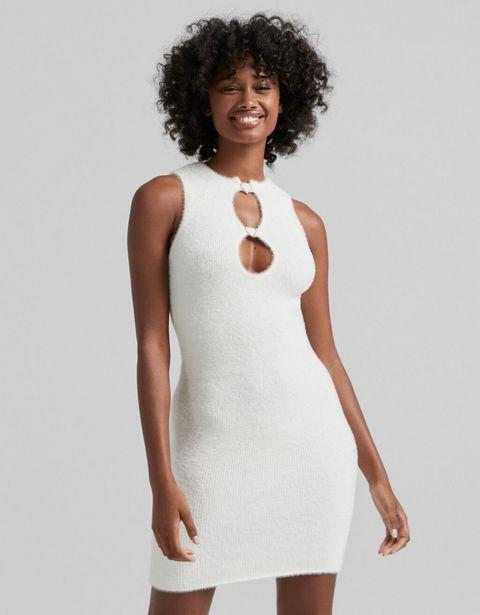 Sukienka ze sztucznego futerka z biżuteryjnymi sercami za 83,4 zł